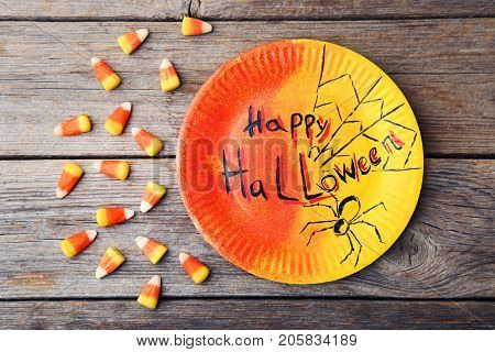Halloween Candy Corns With Plate On Grey Wooden Table