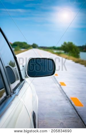 A Side View Mirror of a Car on a Road Trip