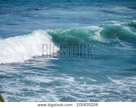 Blue wave in tropical ocean. Wave barrel crashing and clear water
