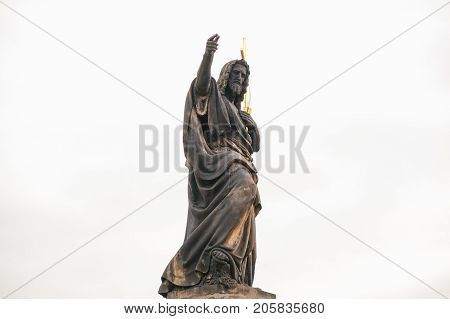 Sculpture of St. John the Baptist. One of the ancient statues on the Charles Bridge in Prague in the Czech Republic.