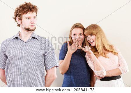Two Women Talking Gossiping About Man.