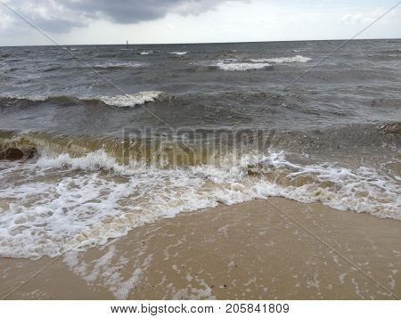 Waves smashing in on the beach in Mississippi