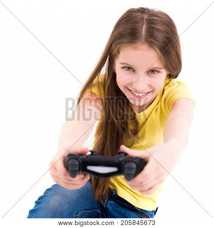 Lovely happy girl smiling widely and playing using joystick, ready to win in computer game