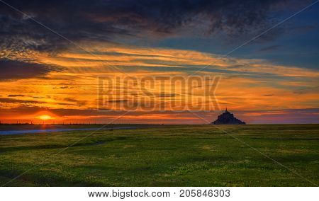 Beautiful colorful sunset near the famous Mont Saint Michel Abbey in Normandy in North of France.