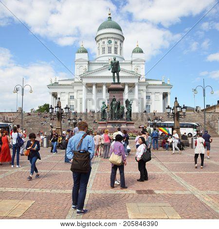 Helsinki, Finland - July 26, 2017: Tourists in Senate Square near Cathedral in Helsinki
