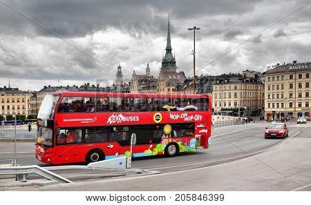 Stockholm, Sweden - July 25, 2017:  Red touristic Hop on Hop off city sightseeing bus in Stockholm
