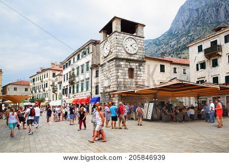 Kotor, Montenegro - June 15, 2017: Tourists in the Square of the Arms in Old town of Kotor
