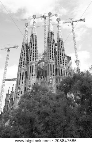 Barcelona, Spain - June 09, 2011:  Bell towers of The La Sagrada Familia cathedral by Antoni Gaudi in Barcelona. Black and white image