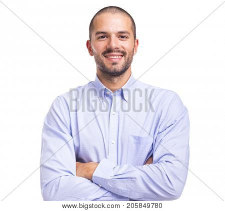 Handsome smiling young man with arms crossed on a white background