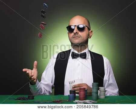Player throwing poker chips at the table