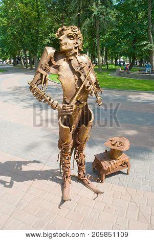 Vinnitsa,Ukraine, MAY  26, 2012:  Modern city metal sculpture-street musician-violinist