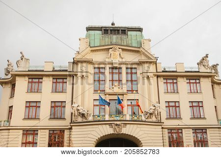 New Town Hall on the eastern side of the Mariinsky Square in Prague in the Czech Republic. Municipal building. Hanging flags on the entrance.