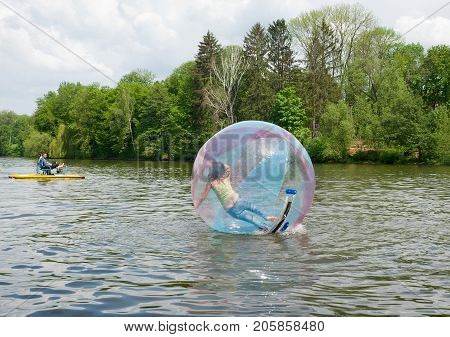 Uman,Ukraine, MAY  09, 2009: Water attraction for children and adults - a bowl on the water,  zorb