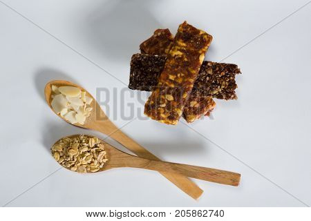 Close-up of cereal bars with cereals in spoon ready for breakfast