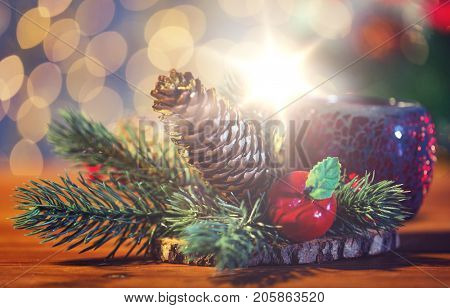christmas, decoration, holidays and new year concept - close up of natural fir branch decoration and fir-cone and lantern on wooden table