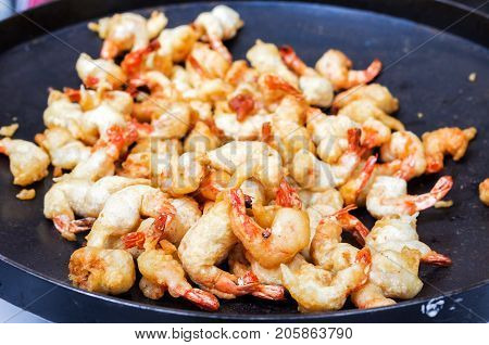 Cooked prawns. Large shrimps are cleaned. Shrimp in a frying pan.