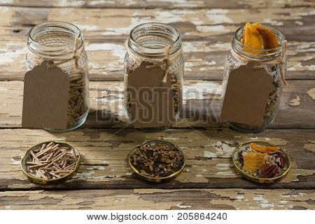 Three jar with various breakfast cereals on wooden table