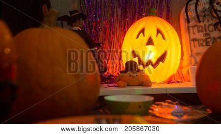 A photo of scene of an office party with fun lighthearted Halloween decorations
