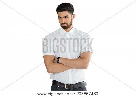 Handsome man standing with arms crossed against white background