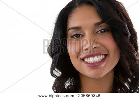 Close up portrait of smiling young woman against white background