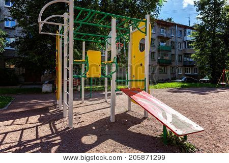 Public's playground in city. Colorful playground on yard in the park. Park with set of modern kids playground background. children Stairs Slides equipment