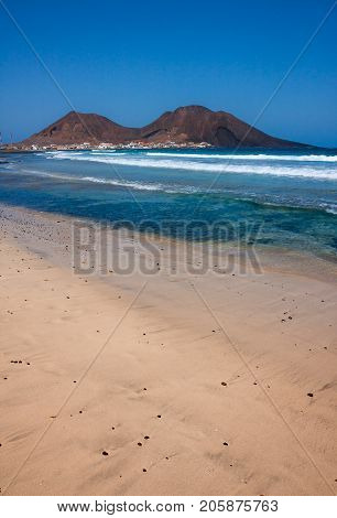 Beach on Sao Vicente Island, Calhau town at extinct volcano crater in Cape Verde