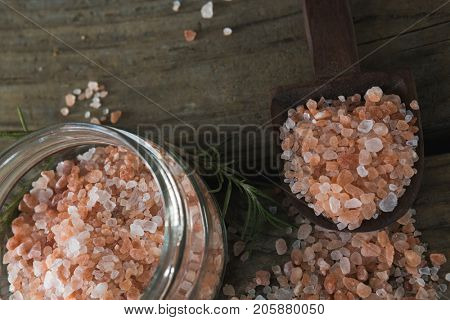 Close-up of himalayan salt and rosemary on wooden table
