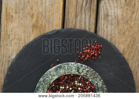 Close-up of mix peppercorns on board