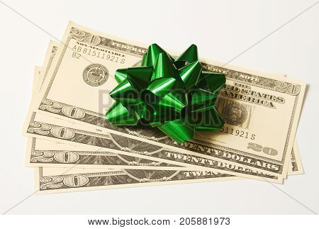 U.S currency money with a bow for a gift.