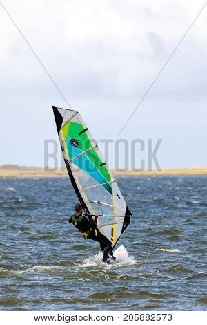Iles de la Madeleine - 4 September 2017:  Canada Young man windsurfing in Iles de la Madeleine, Canada. This is regarded to be the premier location for the sport in North America.