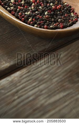 Close-up of mix peppercorns in wooden bowl