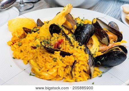 Prawn with rice - closeup of prawn with rice - traditionnal spanish food paella