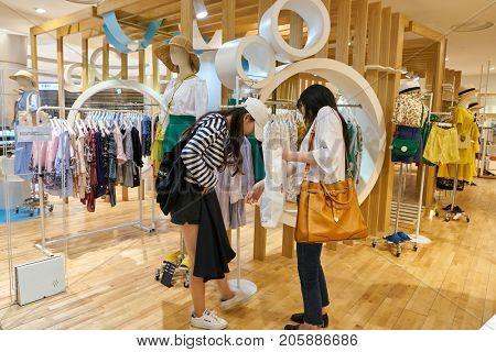 BUSAN, SOUTH KOREA - MAY 28, 2017: women browsing clothing TWEE store at Lotte Department Store