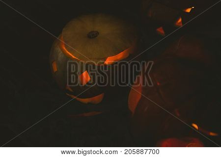 High angle view Illuminated jack o lanterns in darkroom