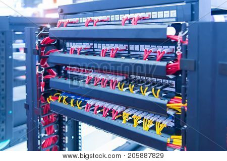 Network panel switch and internet cable in data center.