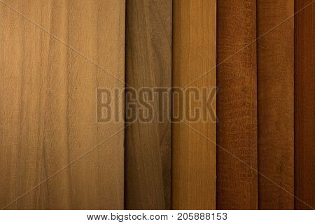 Brown Stained wood panel samples aligned.
