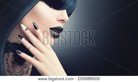 High Fashion Halloween Model Girl Portrait with Trendy gothic Black Hair style, Make up, dark Manicure and accessories. Halloween Party Vampire Woman with black matte lips, fringe hairstyle, choker