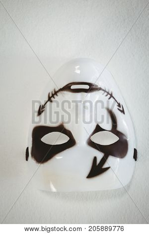 Upside down image of mask on white background