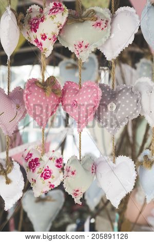 Decorative dangling plush mini hearts for backgrounds