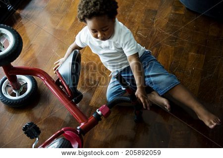 Black kid fell off the bicycle