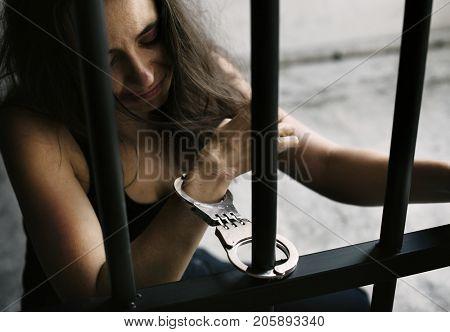 Criminal woman in a prison