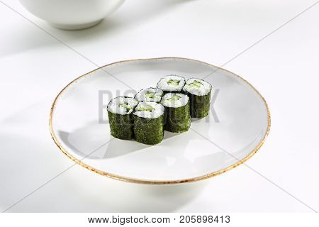 Kappa Maki rolls with cucumber served on white flat plate. Asian menu for gourmets in luxury restaurant