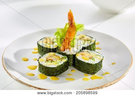 Hot rolls with shrimp and crispy salad served on white flat plate. Asian menu for gourmets in luxury restaurant