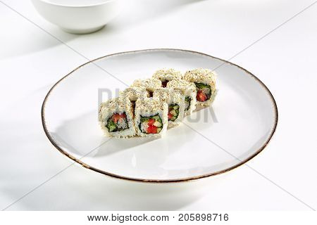 Yasai rolls with vegetables served on white flat plate. Asian menu for gourmets in luxury restaurant