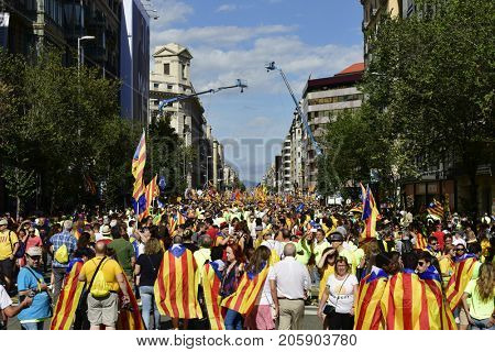 BARCELONA, SPAIN - SEPTEMBER 11, 2017: People partaking in the rally in support for the independence of Catalonia in Barcelona, Spain, during its National Day