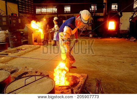 man work in Steel Factory and fire