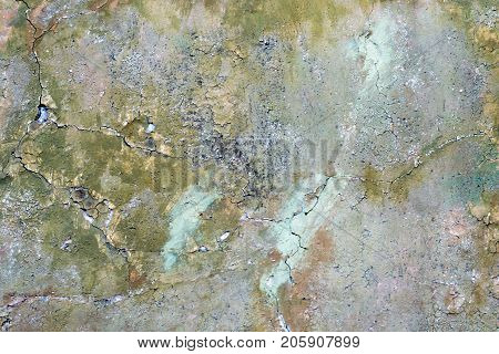 Wall is painted with a multicolored paint which is irradiated background