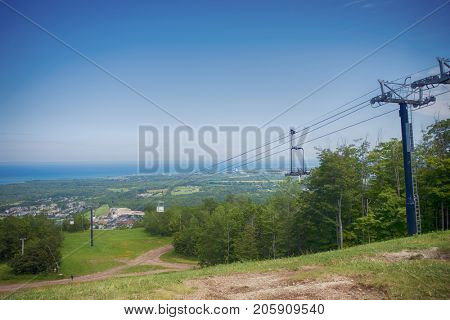 View of summer landscape above Blue Mountain Ski Resort with a chairlift in Collingwood, Ontario