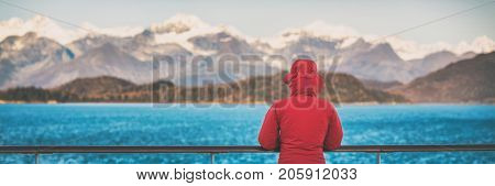 Alaska cruise nature travel tourist banner woman watching nature landscape from boat, panorama crop, in inside passage, Glacier Bay, USA.
