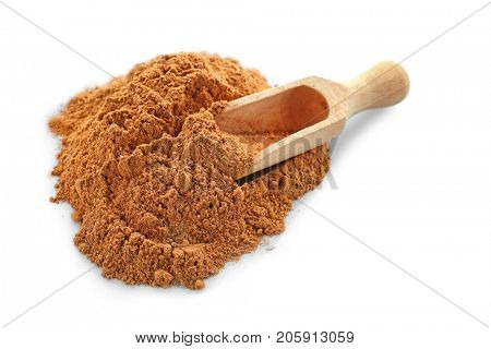 Pile of cumin spice and wooden scoop on white background